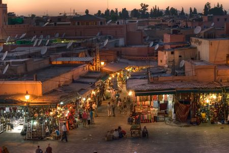 sunset on Djemaa El-fna place and souk, marrakesh, morocco Stock Photo