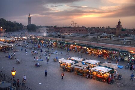 sunset on Djemaa El-fna place and koutoubia mosque, marrakesh, morocco Stock Photo