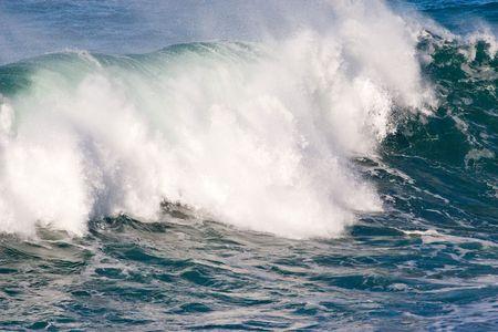 heave: powerful ocean wave approaching coast  Stock Photo