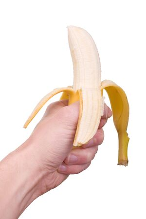 steadily: male hand holding steadily a banana isolated on white, virility symbol