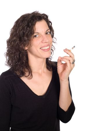women smoking: brunette woman smoking and smiling on white background