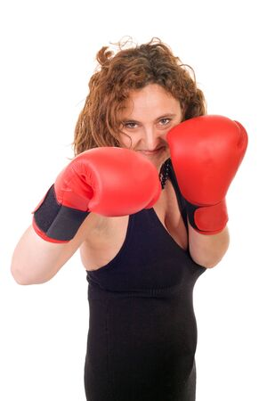 woman boxing with red gloves on white background photo