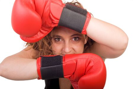 boxing woman looking between her  arms on white background photo