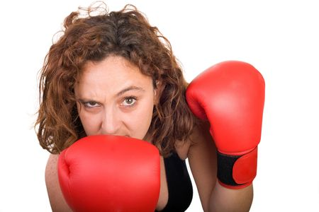 funny and menacing boxing woman on white background photo