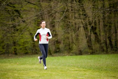 woman running in beautiful park with green grass Stock Photo - 2753682