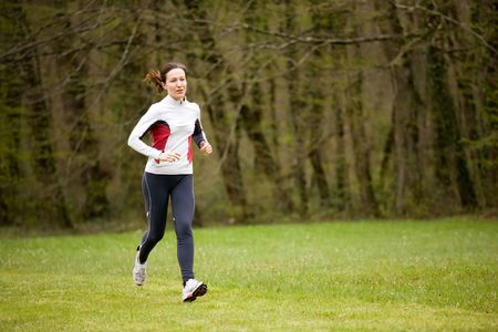 woman running in beautiful park with green grass Stock Photo - 2753641