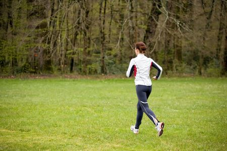 woman running in fresh nature grass in the morning Stock Photo - 2753681