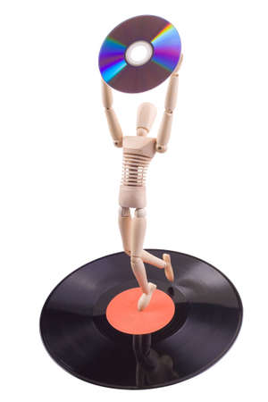 wooden mannequin on vinyl disc holding dvd photo
