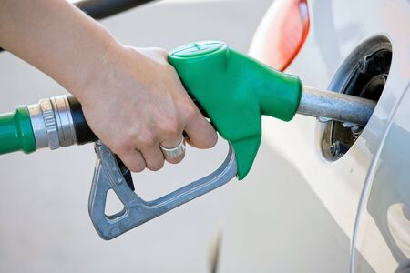 fuel economy:  filling up car tank at gas station Stock Photo