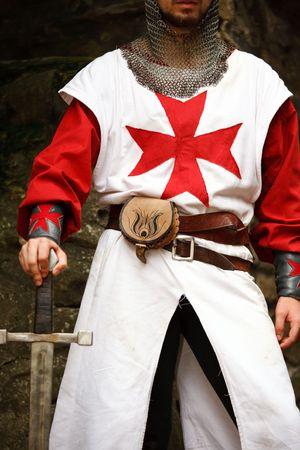 templar: man wearing templar medieval suit and holding sword
