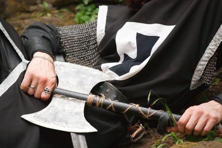 templar: seated medieval templar knight holding axe