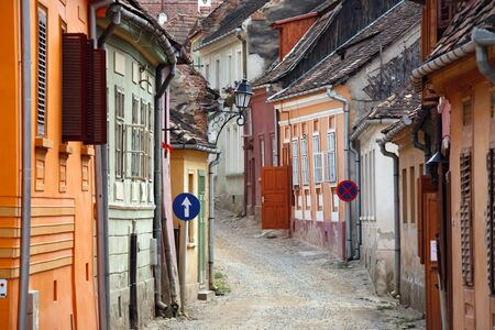 colored street in sighisoara medieval town, romania photo