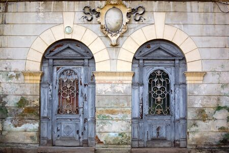 two wooden ancient doors in medieval village Stock Photo
