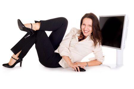 donne mature sexy: sexy d'affari azienda mouse del computer contro schermo LCD Archivio Fotografico