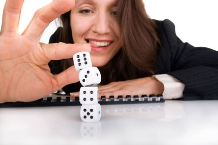 businesswoman making dice pile to have answer Stock Photo - 3572054