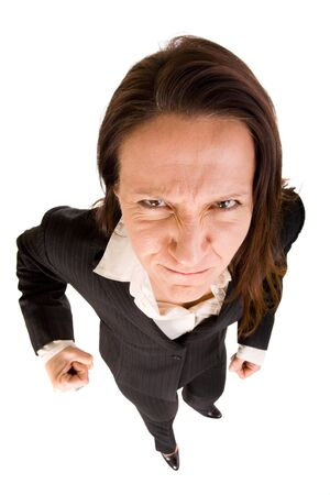 dynamic view of angry and aggressive businesswoman photo