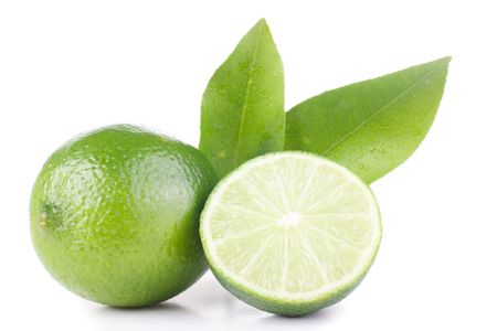 green lemon and leaves isolated on white photo