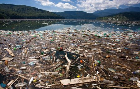 beautiful mountain and lake landscape ruined by heavy trash pollution