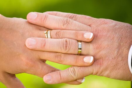 man and woman hands with wedding rings Stock Photo - 3841372