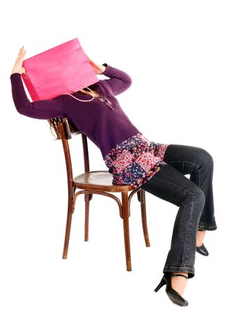 seated woman with head inside shopping bag Stock Photo - 3976427