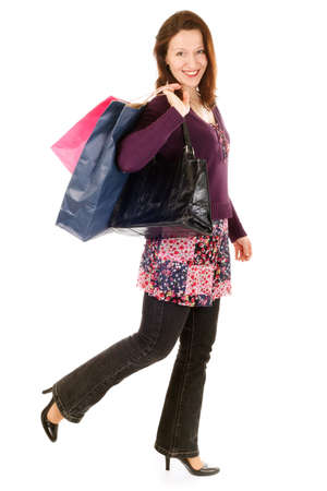 smiling woman holding shopping bags and walking Stock Photo - 3976425
