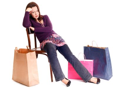 upset woman resting on chair after shopping Stock Photo - 3976437