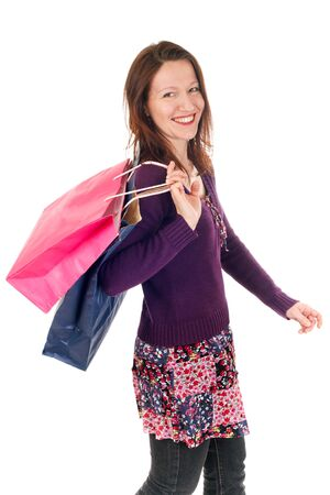 woman walking and holding shopping bags over white Stock Photo - 3993781