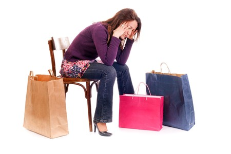woman seated on chair very tired after shopping