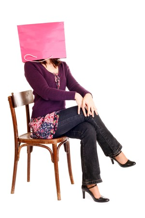 seated woman with head inside shopping bag Stock Photo - 3993780