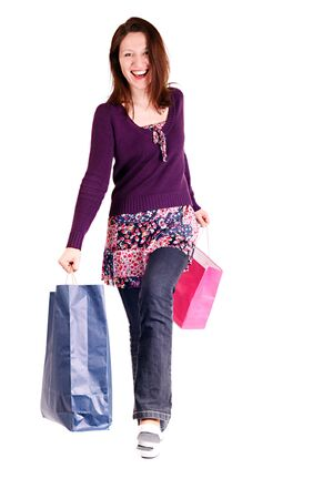 smiling woman holding shopping bags and walking Stock Photo - 3993778