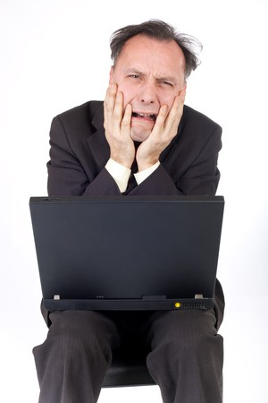 catastrophic: desperate businessman looking at computer and crying