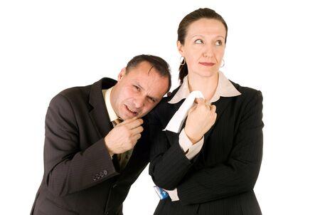 businessman crying, upset businesswoman giving him a handkerchief photo