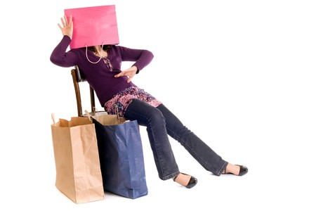 seated woman with head inside shopping bag Stock Photo - 4110238
