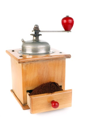 full coffee mill  isolated on white background  photo