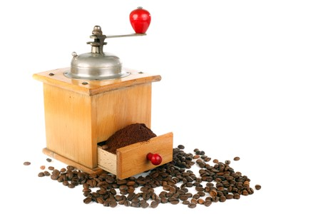 wooden coffee mill and beans isolated on white photo