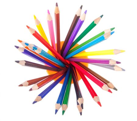 disposed: wide angle top view of assorted color pencils disposed in circle in a cup