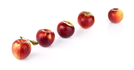 disposed: five red apples disposed in row, focus on the first one Stock Photo