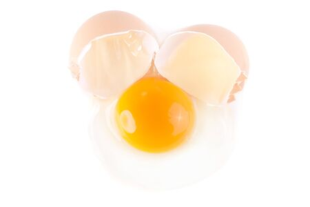 albumin: uncooked broken egg isolated on white background