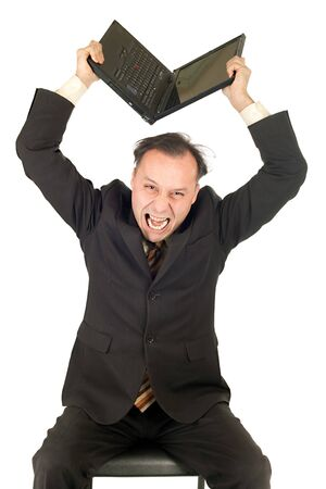 furious business man breaking his computer on white background photo