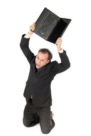 furious businessman breaking his notebook isolated on white photo