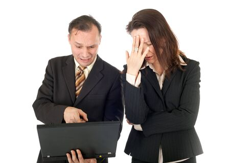 desperate Businesspeople looking bad news on computer photo