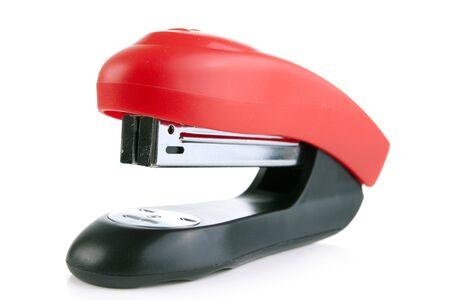 affix: red stapler isolated on white background