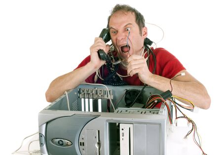 angry person: very upset man lost in computer cables yelling at hotline support