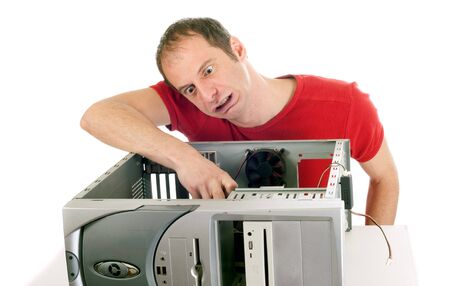 upset man making grimace and trying to repair the computer Stock Photo - 4304968