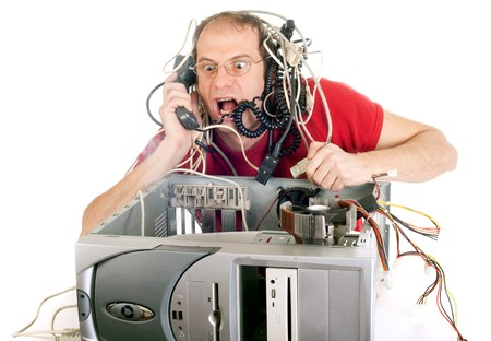 hotline: man in panic with his computer trying to reach hotline