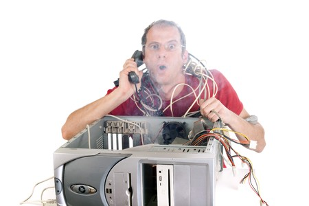computer cable: man on the phone trying reach hotline while smoke is coming from computer
