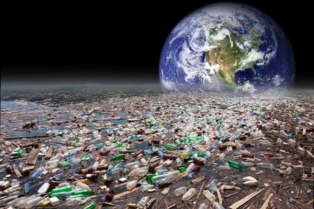 consumerism: image showing earth sinking in heavy water pollution with tons of plastic containers Stock Photo