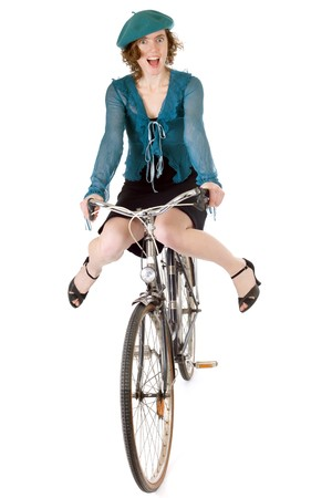 riding bike: happy pretty woman making acrobatic figure on bicycle