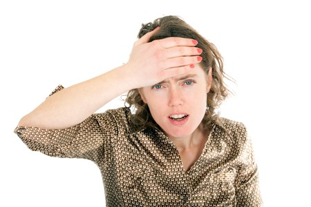 hand on forehead: young woman having headache putting hand forehead