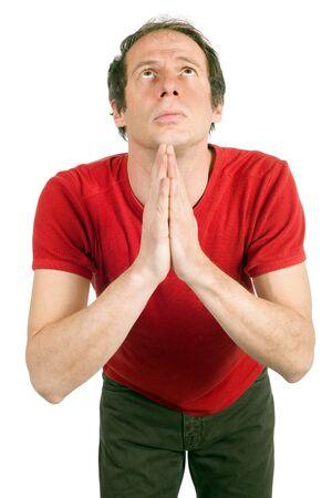 portrait of sad man praying isolated on white photo